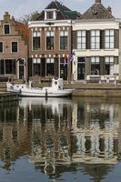 Houses near canal at Makkum, Friesland.