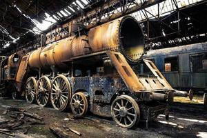 Old trains at abandoned train depot photo