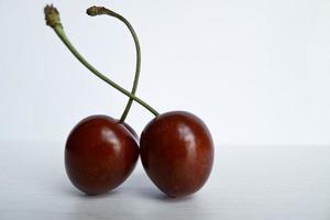 Pair of ripe cherries .