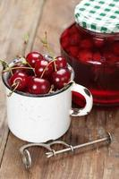 Sour cherry fruits and jam photo