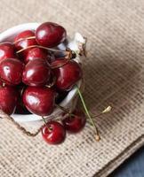 Cherris in a small decorative bucket photo