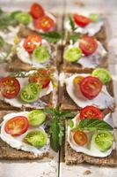Slice of whole wheat bread and cherry tomatoes photo