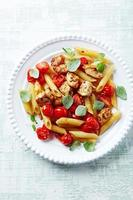 Penne with chicken and cherry tomatoes