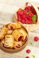 Raspberry filled pastries photo