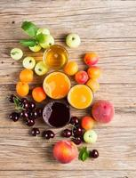 Juices and fruits, view from above.