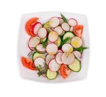 Radish salad with tomatoes. photo
