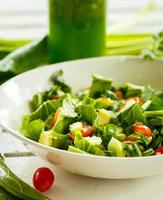 Fresh salad and green smoothies photo
