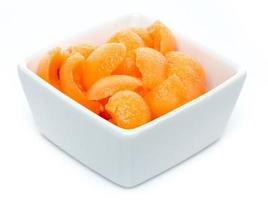 Cup of small melon pieces photo