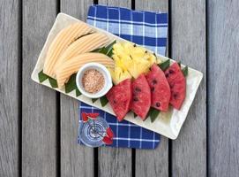 Mixed thai fruit on wooden floor background photo