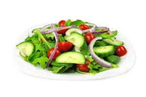 Garden salad on plate, isolated on white
