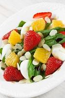 Spinach strawberry orange quail eggs salad with almonds slices