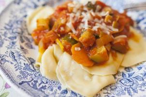 ravioli with vegetable sauce photo