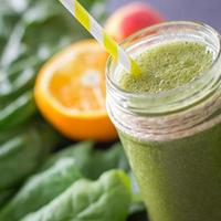 Blended green smoothie with ingredients selective focus photo