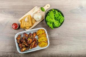 Sticky chicken wings with garlic panini bread photo
