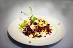 original salade with mushrooms isolated on white background photo