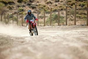 Man riding dirt bike photo