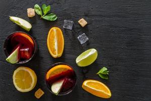 Sangria ingredients - orange, lemon and lime slices, wine