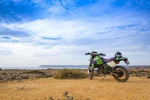 enduro motorbike on the rock photo