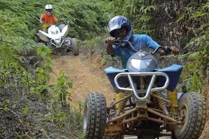 Young Asian Man riding  ATV