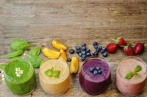 smoothie with blueberries, peach, spinach photo