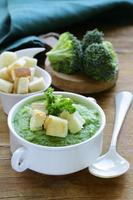 vegetable broccoli cream soup with white croutons and parsley