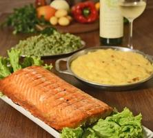 grilled salmon fillet on table photo