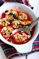 Baked plums with muesli crumble topping