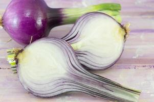Young garlic on a magenta wooden board photo