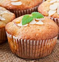 Muffins with plums and almond petals