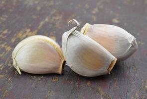Garlic on a wooden floor photo