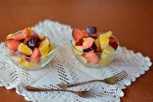 Fresh fruit mixed salad in the glass bowl photo