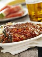 Rack of BBQ Ribs with a Beer photo