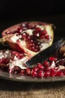Moody natrual lighting images of fresh juicy pomegranate with vi