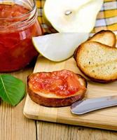 Bread with pear jam and leaf on board photo