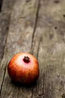 Pomegranate on a rustic wooden bench