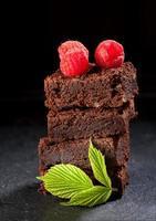 Chocolate cake brownies with raspberries