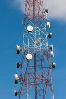 Telecommunication tower under blue sky photo