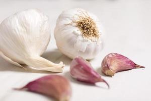 Fresh garlic on light wood