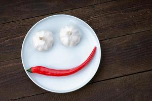 Smiley face made from pepper and garlic