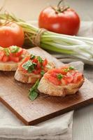 Italian bruschetta with tomatoes onion and basil