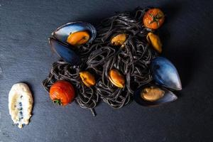 Pasta with cuttlefish ink and mussels