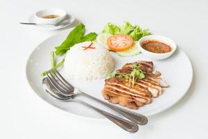 Grilled pork with garlic fried rice. photo