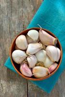 garlic in a wooden bowl photo