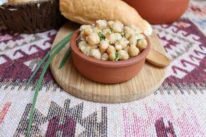 Dish of chickpeas with herbs and olive oil