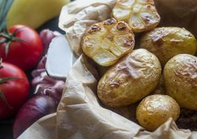 baked potatoes with garlic and fresh vegetables photo