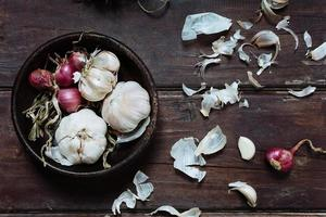Garlic bulbs and red onions photo
