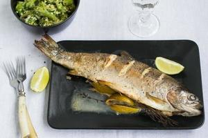 Grilled rainbow trout with thyme and lemon photo