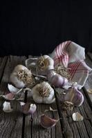 Russian Red Garlic bulbs and cloves on rustic wooden surface