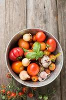 different varieties of tomatoes with garlic, basil.