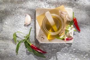 Olive oil, garlic and chili photo